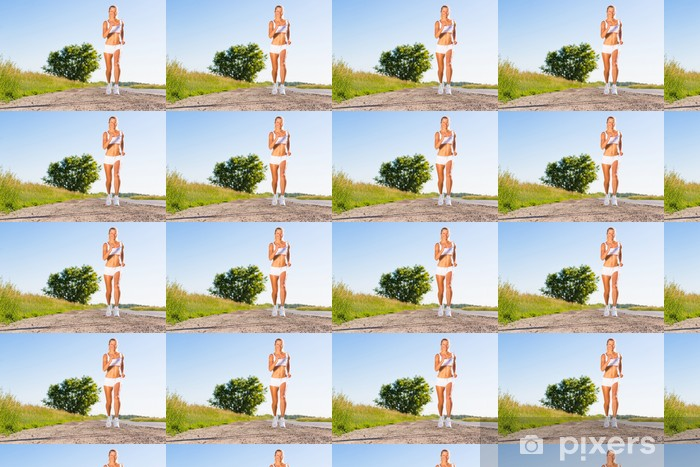Tapeta na wymiar winylowa Młoda kobieta sportowiec działa na drodze - Tematy
