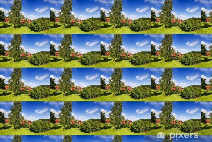 Vinyltapete nach Maß Alte rote Ferienhäuser in grünen üppigen Sommer Umgebung - Jahreszeiten