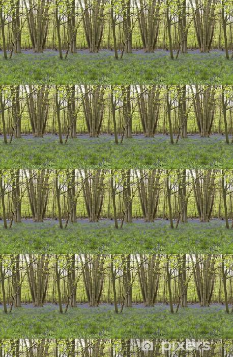 Vinylová tapeta na míru Hyacinty květy v lese na jaře - Stromy