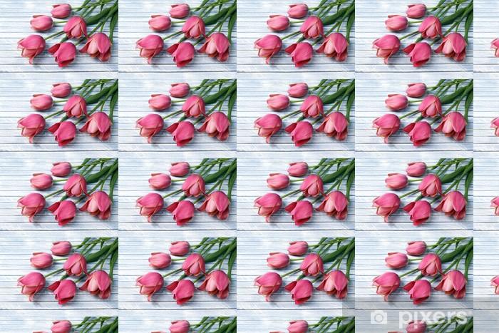Tapeta na wymiar winylowa Piękne różowe tulipany na tle drewniane - Kwiaty