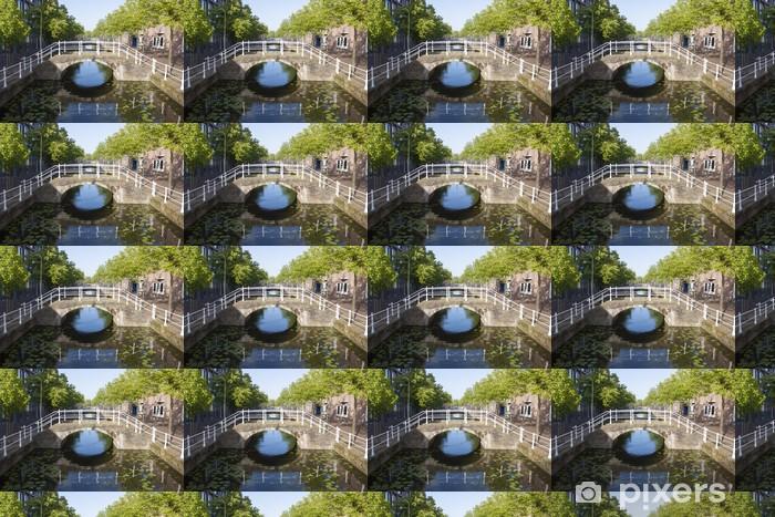 Tapeta na wymiar winylowa Most nad kanałem z refleksji i drzew - Criteo