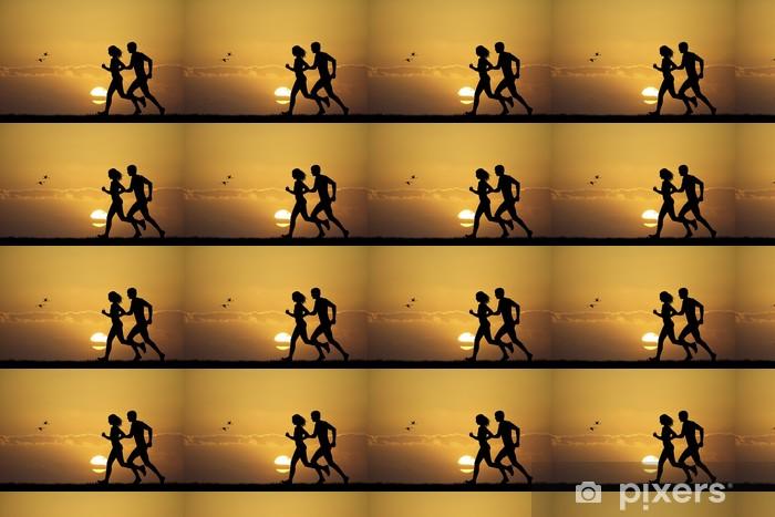 Papier peint vinyle sur mesure Fille et garçon courant au coucher du soleil - Thèmes