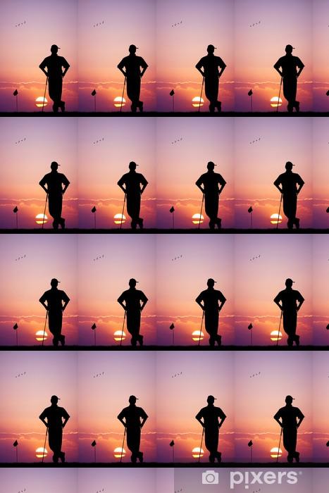 Vinylová tapeta na míru Muž hraje golf při západu slunce - Golf