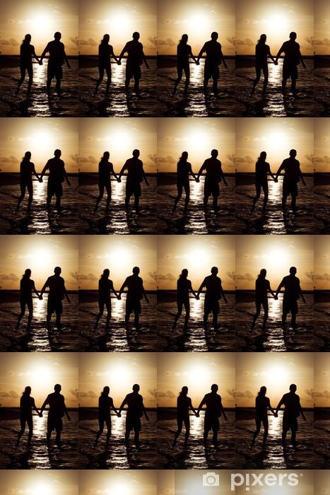 Vinyltapete nach Maß Schattenbild eines jungen Paares bei Sonnenuntergang am Ufer des Océ - Urlaub