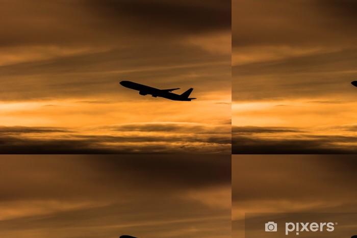 Papel de Parede em Vinil Silhouette airplane in the sunset sky - Ar