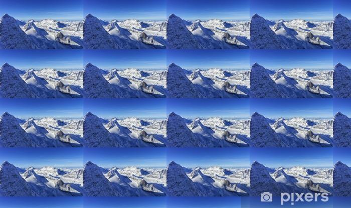 Vinyl behang, op maat gemaakt Rij van sneeuw pieken in Jungfrau regio helikopterview in de winter - Seizoenen