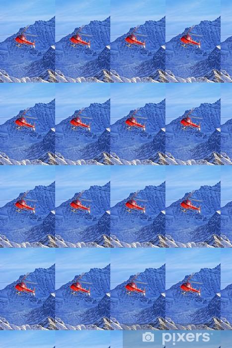 Papier peint vinyle sur mesure Rouge hélicoptère dans les Alpes suisses dans le soleil d'hiver - Saisons
