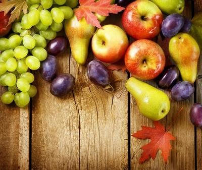 Organic Fruits over wood background. Autumn harvest Framed Poster