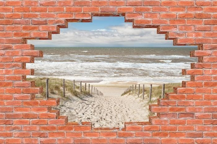 Fototapeta winylowa Dziura w murze - Piasek na plaży w słoneczny dzień - Dziury w ścianie