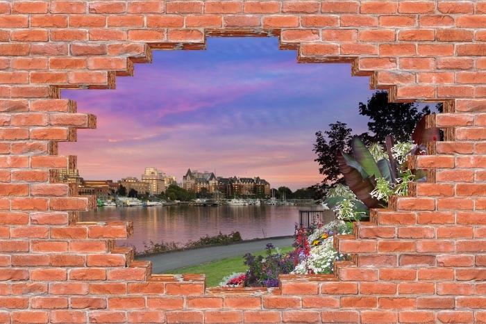 Fototapeta winylowa Dziura w murze - Widok na rzekę. - Dziury w ścianie