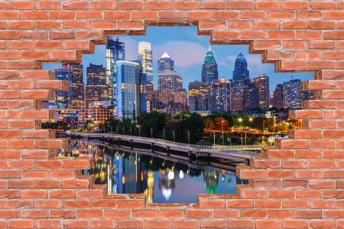 Fototapeta winylowa Dziura w murze - Filadelfia w nocy - Dziury w ścianie