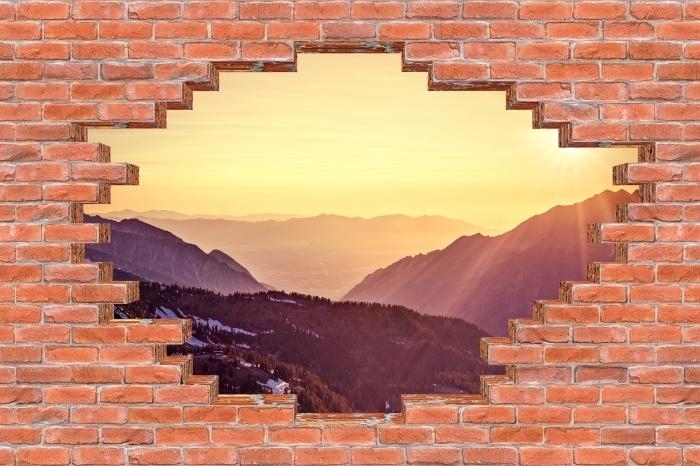 Fototapeta winylowa Dziura w murze - Zachód słońca w górach - Dziury w ścianie