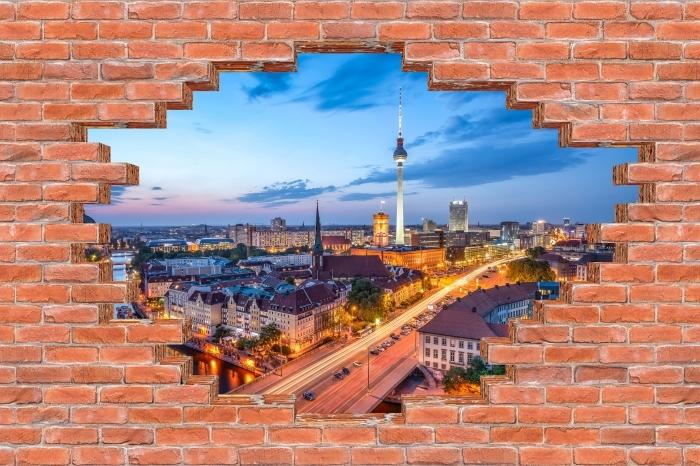 Fototapeta winylowa Dziura w murze - Widok na Berlin - Dziury w ścianie