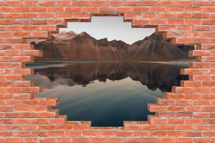 Fototapeta winylowa Dziura w murze - Wyspa - Dziury w ścianie