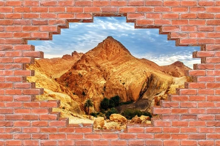 Fototapeta winylowa Dziura w murze - Górskie oazy - Dziury w ścianie