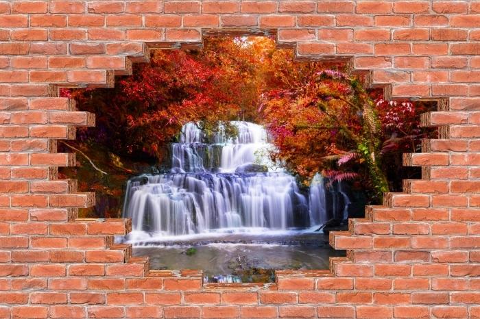 Fototapeta winylowa Dziura w murze - Wodospad w dżungli. Nowa Zelandia - Dziury w ścianie