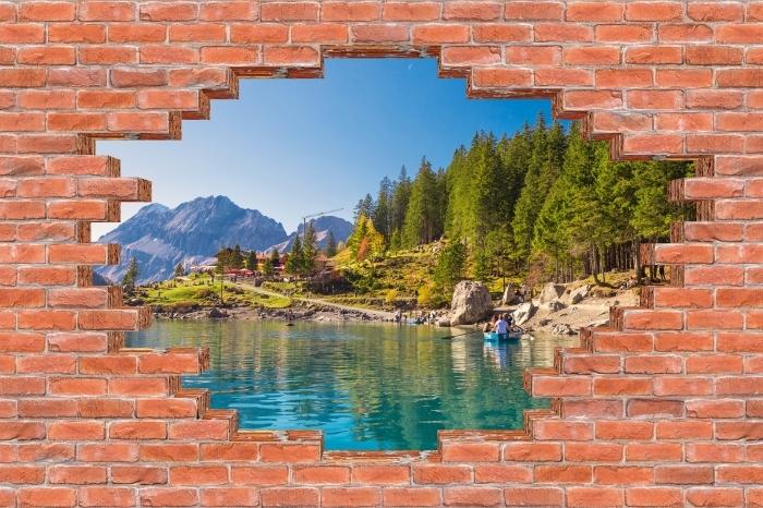 Fototapeta winylowa Dziura w murze - Błękitne jezioro. Szwajcaria. - Dziury w ścianie