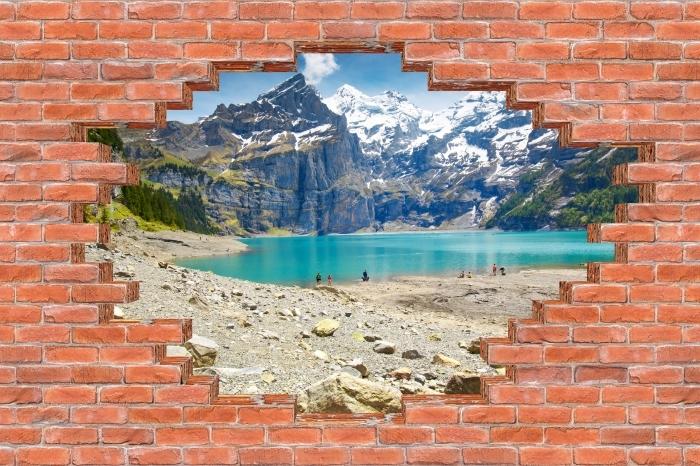 Fototapeta winylowa Dziura w murze - Jezioro. Szwajcaria - Dziury w ścianie