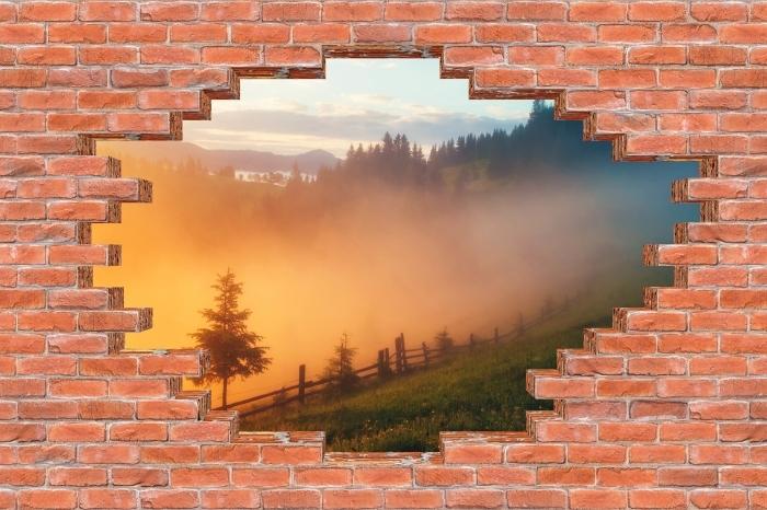 Fototapeta winylowa Dziura w murze - Górskie doliny podczas wschodu słońca - Dziury w ścianie