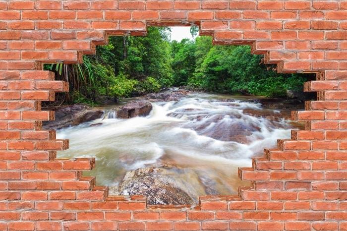 Fototapeta winylowa Dziura w murze - Wodospad w lesie - Dziury w ścianie