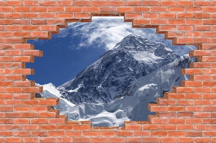 Fototapeta winylowa Dziura w murze - Mount Everest - Dziury w ścianie
