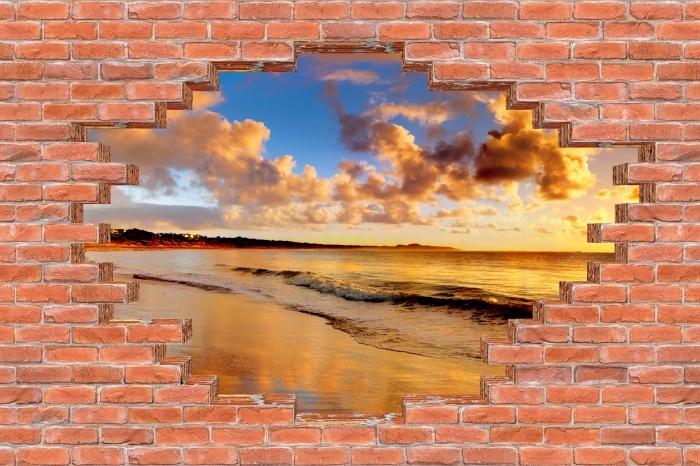 Fototapeta winylowa Dziura w murze - Zachód słońca na plaży - Dziury w ścianie