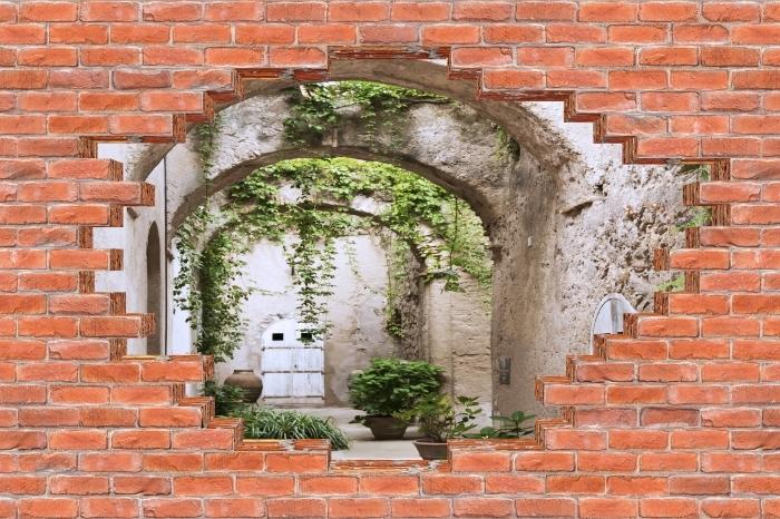 Fototapeta winylowa Dziura w murze - Arkada - Dziury w ścianie