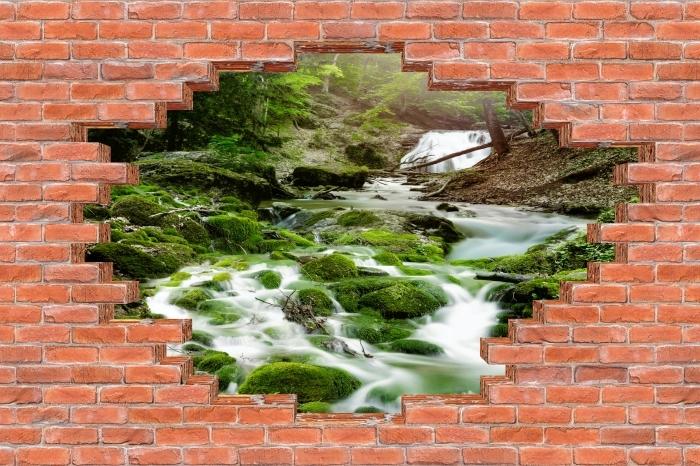 Fototapeta winylowa Dziura w murze - Las i wodospad - Dziury w ścianie