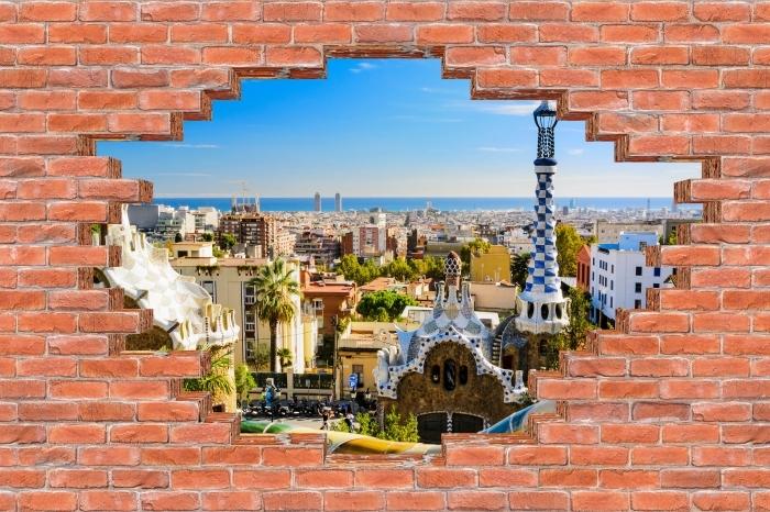 Fototapeta winylowa Dziura w murze - Park Guell w Barcelonie. Hiszpania. - Dziury w ścianie