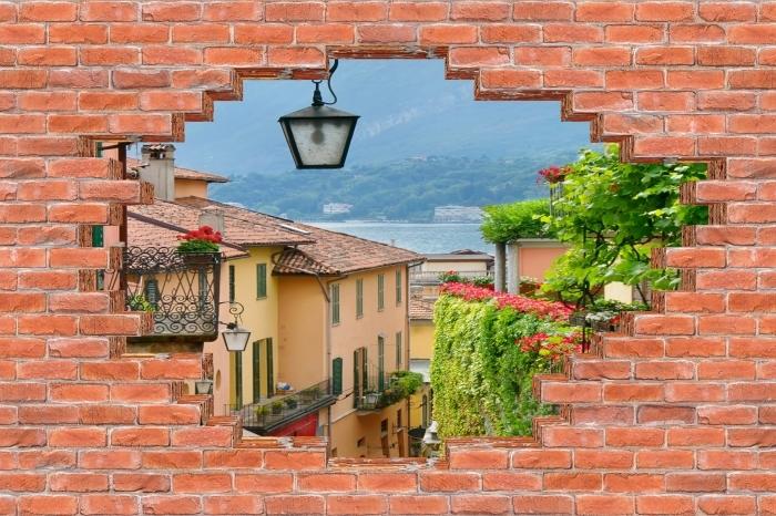 Fototapeta winylowa Dziura w murze - Malownicze miasteczko we Włoszech - Dziury w ścianie