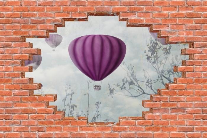 Fototapeta winylowa Dziura w murze - Balony na niebie - Dziury w ścianie