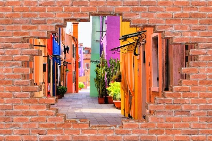 Fototapeta winylowa Dziura w murze - Kolorowa ulica w Burano. Włochy. - Dziury w ścianie