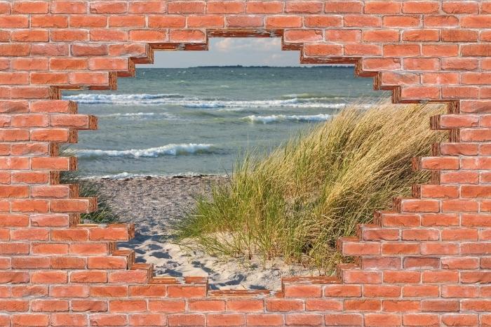 Fototapeta winylowa Dziura w murze - Plaża - Dziury w ścianie