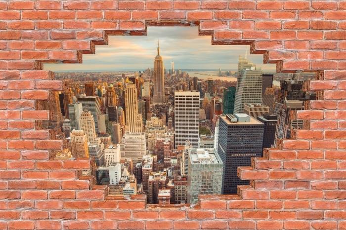 Fototapeta winylowa Dziura w murze - Widok na zachód słońca w Nowym Jorku - Dziury w ścianie