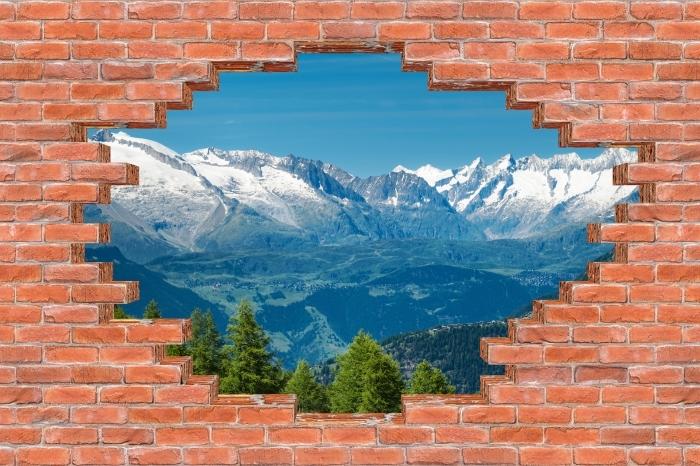 Fototapeta winylowa Dziura w murze - Panorama wysokich górach - Dziury w ścianie