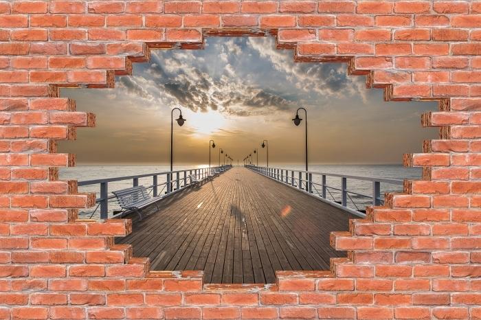 Fototapeta winylowa Dziura w murze - Wschód słońca na molo - Dziury w ścianie