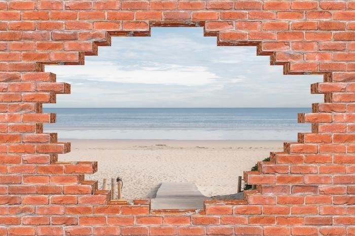 Fototapeta winylowa Dziura w murze - Plaża i morze - Dziury w ścianie