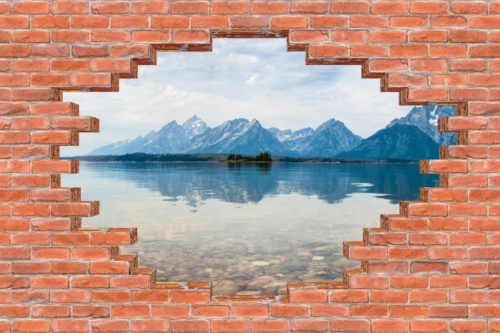 Fototapeta winylowa Dziura w murze - Park Narodowy Grand Teton - Dziury w ścianie