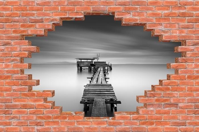 Fototapeta winylowa Dziura w murze - Drewniane molo - Dziury w ścianie