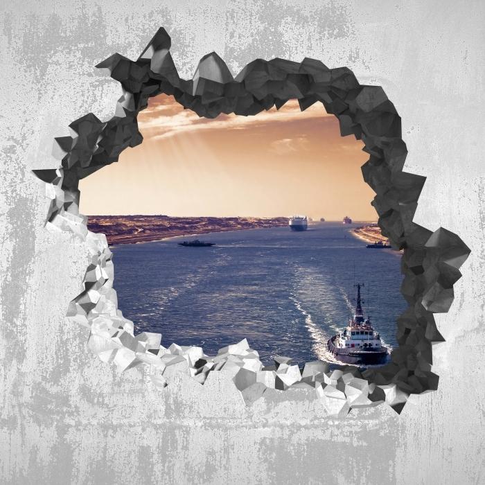 Vinyl-Fototapete Loch in der Wand - Entlang des Flusses - Durchbruch in der Wand
