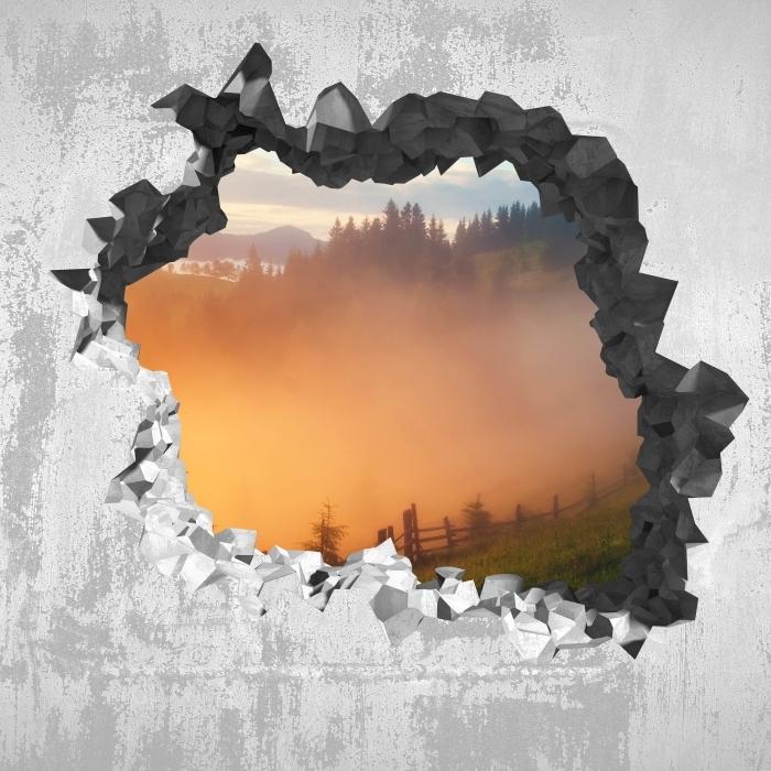 Fototapeta winylowa Dziura w ścianie - Górskie doliny podczas wschodu słońca - Dziury w ścianie