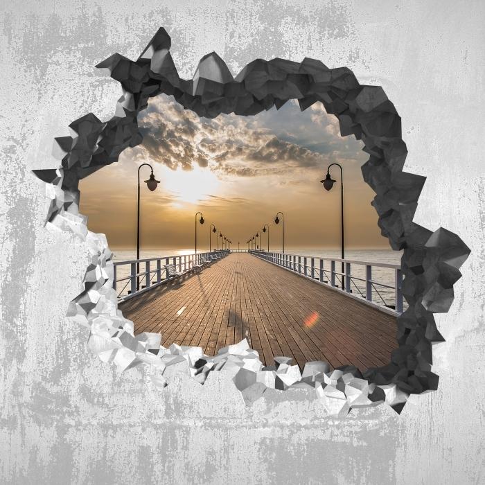 Fototapeta winylowa Dziura w ścianie - Wschód słońca na molo - Dziury w ścianie