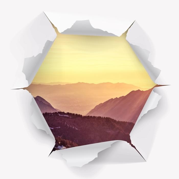 Vinyl-Fototapete Loch in der Wand - Sonnenuntergang in den Bergen - Durchbruch in der Wand