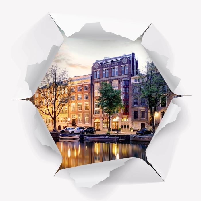Fototapeta winylowa Dziura w ścianie - Amsterdam. Holandia. - Dziury w ścianie