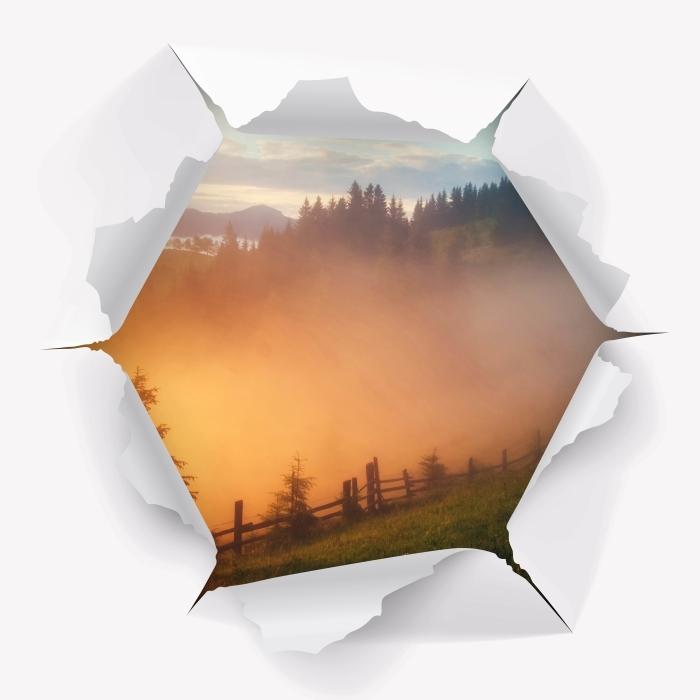 Vinyl Fotobehang Gat in de muur - vallei van de berg tijdens zonsopgang - Gaten in de muur