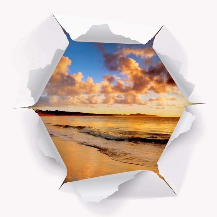 Fototapeta winylowa Dziura w ścianie - Zachód słońca na plaży - Dziury w ścianie