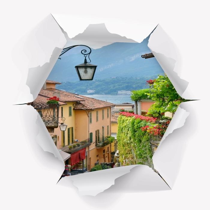 Fototapeta winylowa Dziura w ścianie - Malownicze miasteczko we Włoszech - Dziury w ścianie