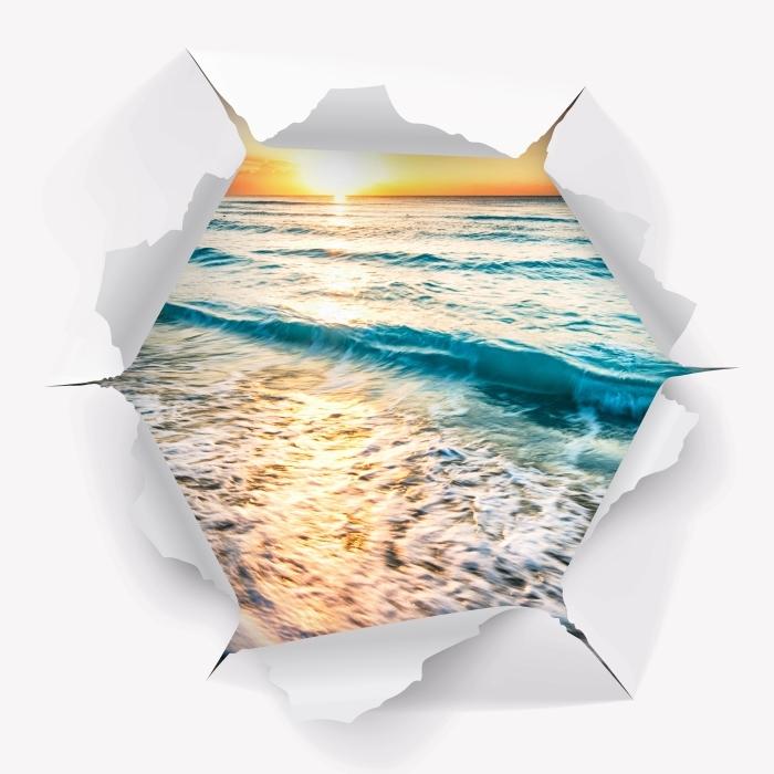 Vinyl-Fototapete Loch in der Wand - Sonnenaufgang am Strand - Durchbruch in der Wand