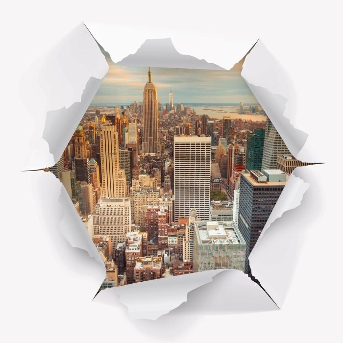 Papier peint vinyle Trou dans le mur - Vue du coucher du soleil à New York - Les trous dans le mur