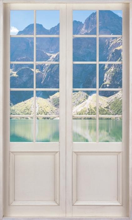 Fototapeta winylowa Białe drzwi - Panorama Morskiego Oka - Widok przez drzwi